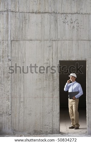 Site manager on construction site - stock photo