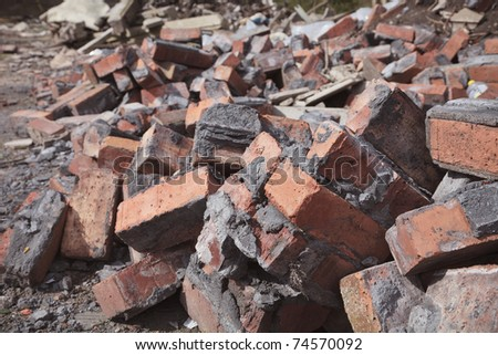 site of a demolished building showing bricks and rubble - stock photo