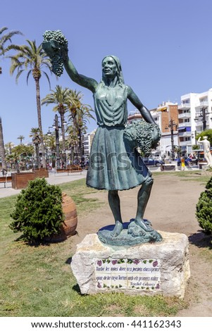 Sitges, Spain - June 7, 2015: Woman s sculpture with a cluster of grapes in Sitges, Barcelona Spain - stock photo