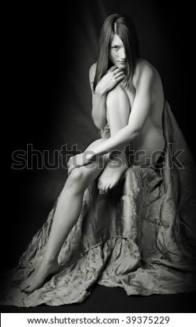 Sitting beautiful naked girl - monochrome photography - stock photo