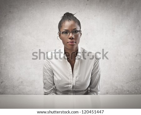 Sitting black girl in white shirt with glasses - stock photo