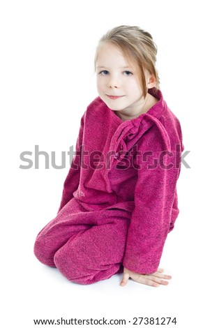 Sitting blonde little girl in purple - stock photo