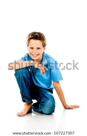 sitting boy isolated on a white background - stock photo