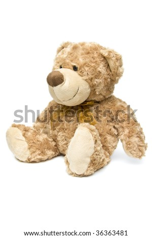 Sitting fluffy brown teddy bear from side - portrait interior - stock photo