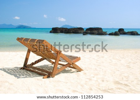 Sitting in front of Rock strange at Koh Kham of Koh Mak in Thailand - stock photo