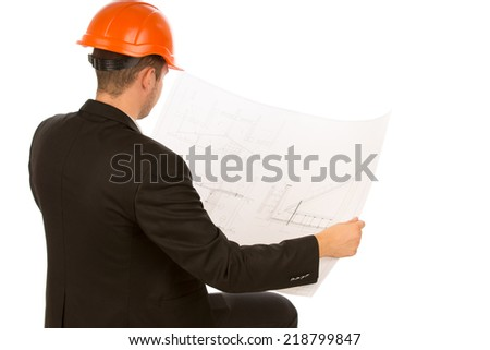Sitting Male Engineer in Black Coat Looking at Blueprint Design on White Background. - stock photo