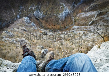 Sitting on cliff and looking at the river - stock photo