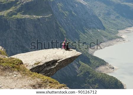 Sitting on the edge - stock photo