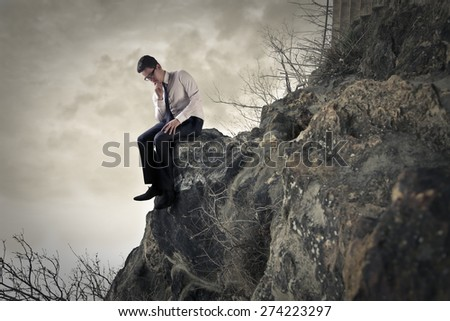 Sitting on the rocks - stock photo
