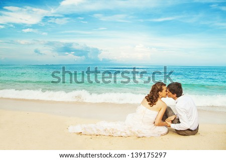 sitting on the sand - stock photo
