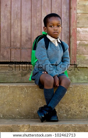 Sitting on the steps and waiting to go to school.t - stock photo