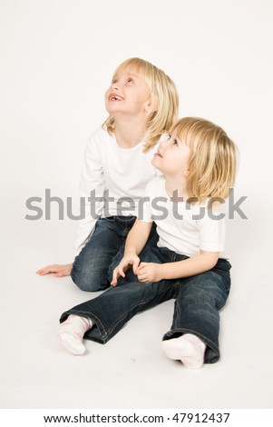 Sitting sisters - stock photo