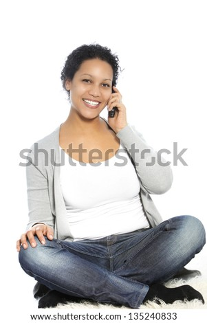Sitting woman smiling while calling through her cellular phone - stock photo