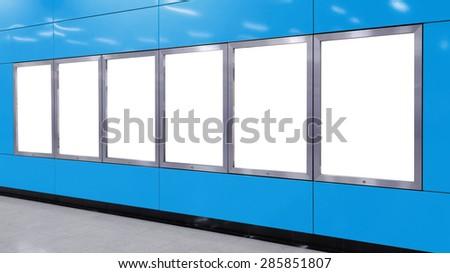 Six big vertical / portrait orientation blank billboard on modern red wall - stock photo