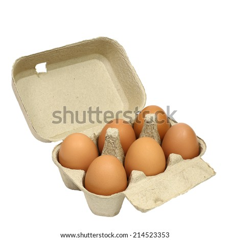 Six brown eggs in a carton package isolated with clipping path  - stock photo