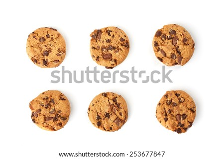 six chocolate cookies on white background top view - stock photo