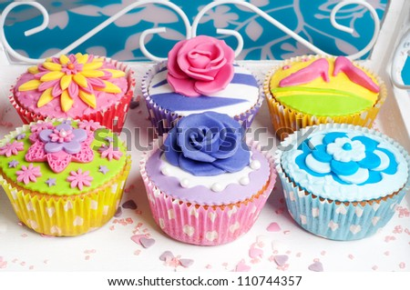 Six colorful party cupcakes for wedding or birthday party - stock photo