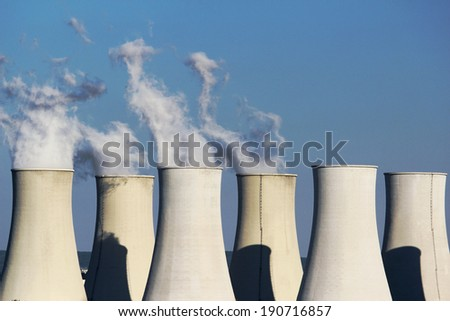 six cooling towers of nuclear power plant - stock photo