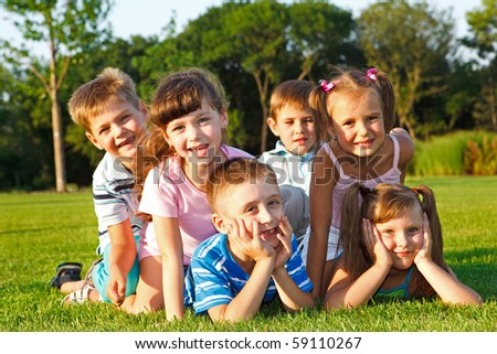 Six excited preschool friends in the backyard - stock photo
