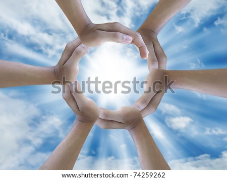 six hand holding the sun - stock photo