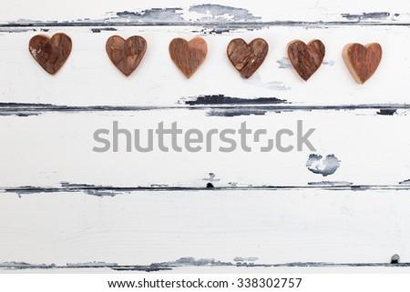 six heart shaped bark decoration on vintage background - stock photo