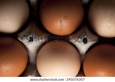 Six home-farmed organic eggs. - stock photo