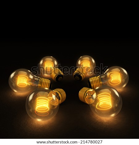 Six illuminated incandescent light bulbs in a circle on a dark background - stock photo
