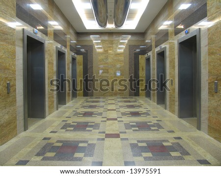 Six lifts in a modern office building - stock photo