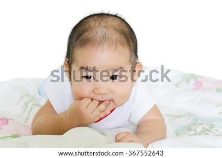 Six month baby sucking his fingers. - stock photo