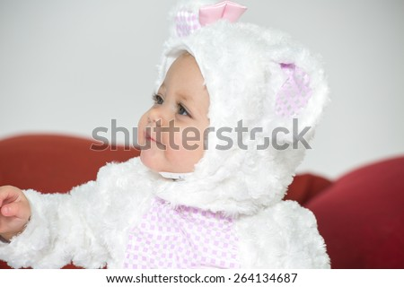 six month girl in white rabbit costume - stock photo
