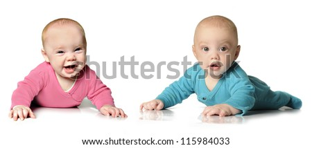 Six month old twin brother and sister on white - stock photo