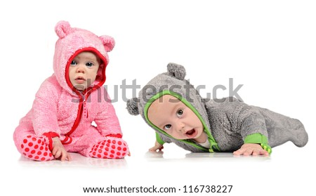 Six month old twin brother and sister on white background - stock photo