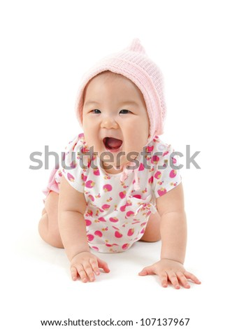 Six months old Asian mixed race baby girl crawling over white background. - stock photo