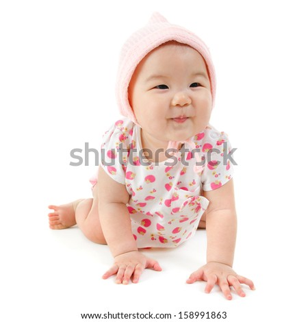Six months old Asian mixed race baby girl crawling over white background, isolated. - stock photo