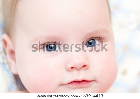 Six months old baby girl closeup portrait. Shallow depth of field - stock photo