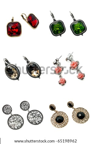 six pairs of bright colourful earrings isolated on white - stock photo