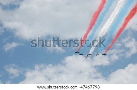 Six planes with red, white, and blue smoke trails flying in formation - stock photo