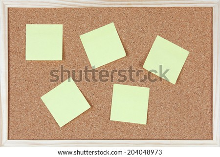 Six post-it notes sticked on corkboard. - stock photo