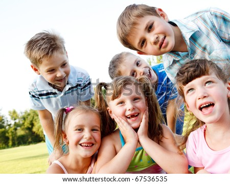 Six preschool friends looking in camera and laughing - stock photo