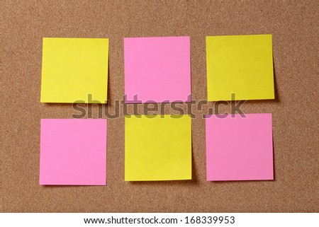 six reminder sticky notes on cork board, empty space for text - stock photo