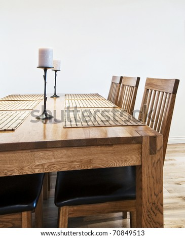 six seat massive wood dining table with chairs - stock photo