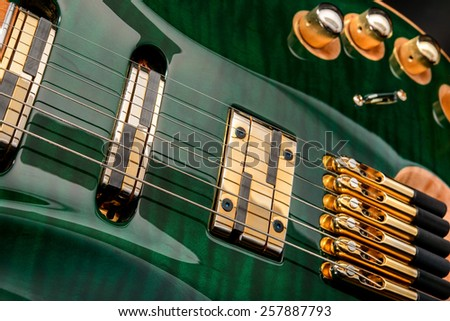 Six-string electric guitar close-up - stock photo