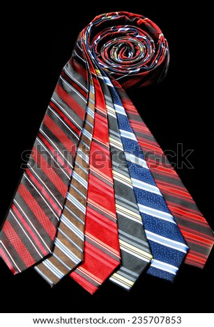 Six ties of different colors. Shot on black background. - stock photo