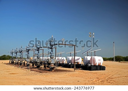 Six well is in operation with wellheads and collection system. - stock photo