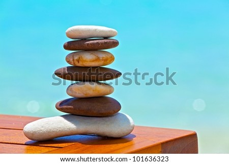 Six white and brown stones are on  beach table - stock photo