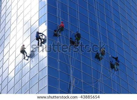 Six workers washing windows - stock photo