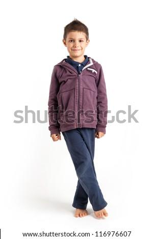 Six year kid, against white background. Full body portrait. - stock photo