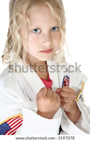 Six year old in taekwondo uniform and stance. - stock photo