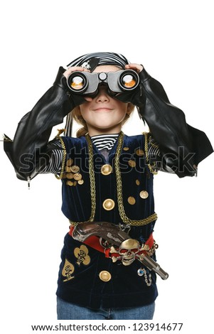 Six years girl wearing costume of pirate looking away through the binoculars at you, over white background - stock photo