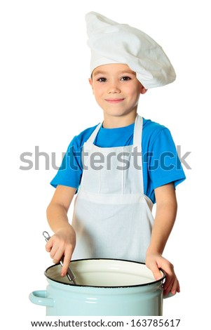 Six years old cook boy with ladle isolated on white - stock photo